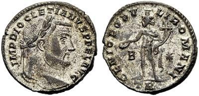 Nummus de Diocleciano. GENIO POPVLI ROMANI. Genio estante a izq. Trier 1618952.m